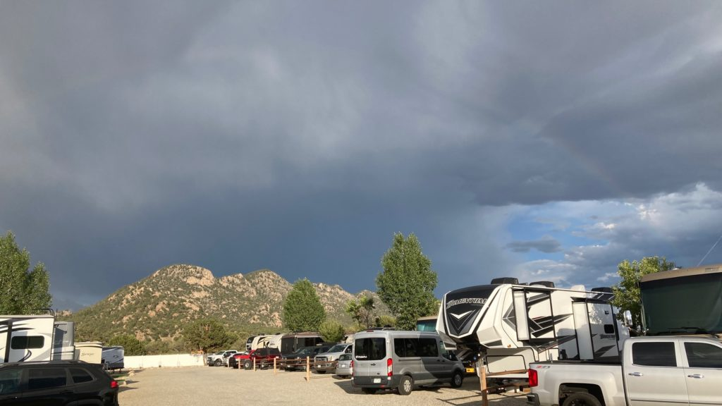 Campsite picture with a rainbow in the background
